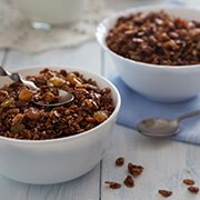 Bowls of granola with raisins and seeds